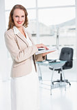 Content pretty businesswoman using laptop