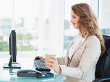 Concentrated pretty businesswoman using computer