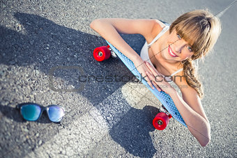 Funky young blonde lying on the road smiling