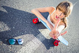Cool skater girl doing rock and roll hand gesture