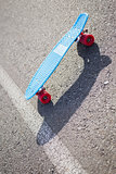 Colorful skateboard on a road