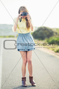 Beautiful stylish photographer taking a picture