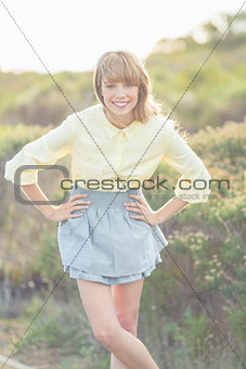 Cheerful attractive blonde posing on natural background