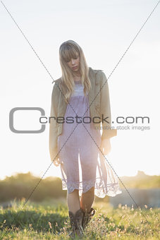 Blonde hipster girl walking in the countryside