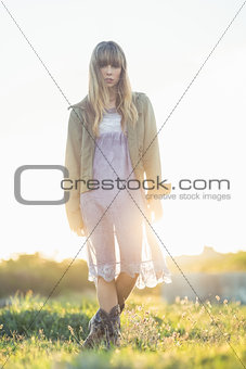 Fashionable young girl in sheer dress and jacket