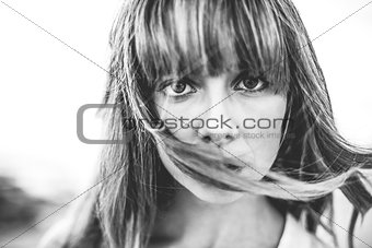 Hipster girl with fringe staring at camera