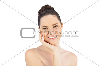 Smiling natural model stroking her face