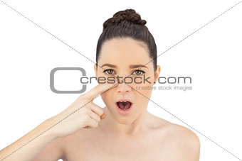 Shocked natural model showing wrinkle on her nose