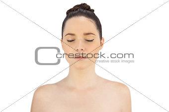 Sensual model posing closing eyes
