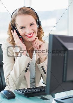 Joyful pretty operator looking at camera