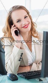Content pretty businesswoman answering a phone call