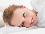 Calm pretty woman lying on her bed