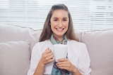 Cheerful pretty model holding cup of coffee