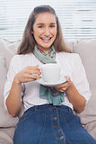 Smiling pretty model holding coffee