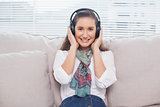 Smiling cute model listening to music