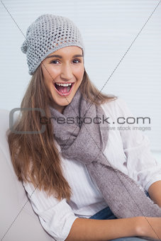 Smiling attractive brunette with winter hat on posing
