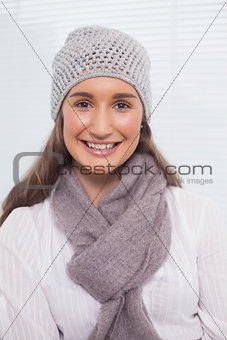 Smiling brunette with winter hat on posing