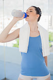 Pretty slender woman hydrating