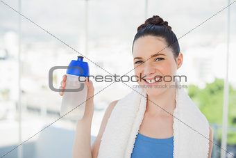 Attractive slender woman holding sport flask