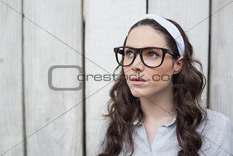 Thoughtful trendy woman posing