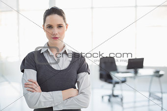 Stern businesswoman posing