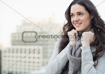 Smiling pretty woman in winter clothes posing