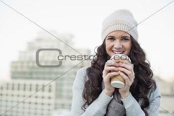 Smiling pretty brunette having coffee
