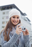 Smiling gorgeous woman with winter clothes on taking picture
