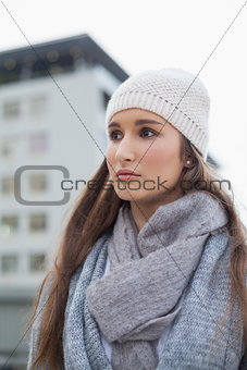 Thoughtful gorgeous woman with winter clothes on posing