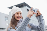Smiling gorgeous woman with winter clothes on taking a self picture