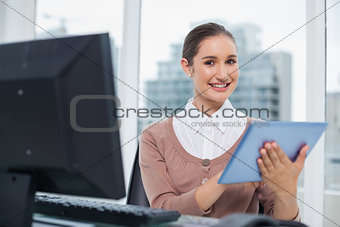 Smiling beautiful businesswoman using her tablet