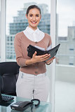 Smiling businesswoman holding notebook