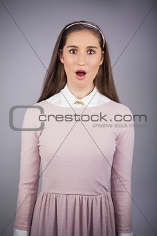 Portrait of shocked pretty model posing