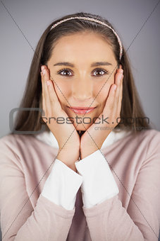 Close up on surprised pretty model posing