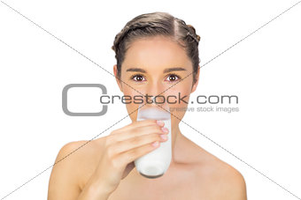 Cute young model drinking milk