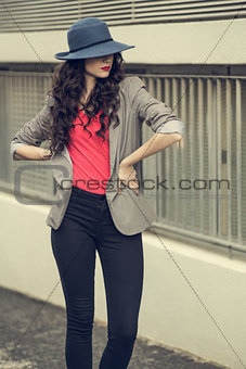 Attractive glamorous brunette wearing stylish clothes posing