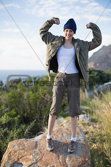 Woman hiking and showing her strength