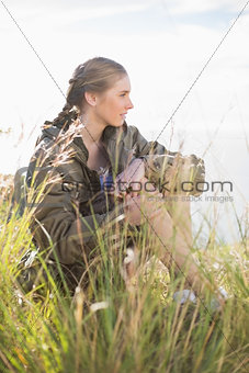 Blonde woman sitting in grass