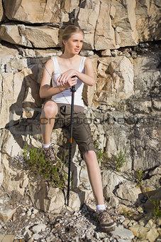 Blonde woman holding hiking pole