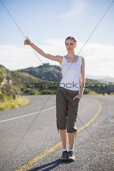 Blonde woman hitching a lift