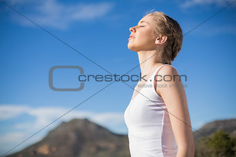 Blonde woman enjoying the sun