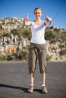 Blonde woman giving thumbs up