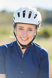 Close up of woman wearing bike helmet