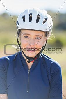 Close up of woman wearing bike helmet