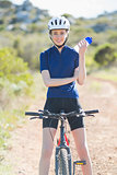 Woman with bike holding bottler