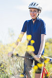 Happy woman holding bike
