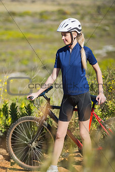 Blonde woman with bike