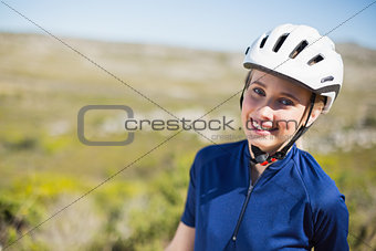 Woman wearing helmet smiling