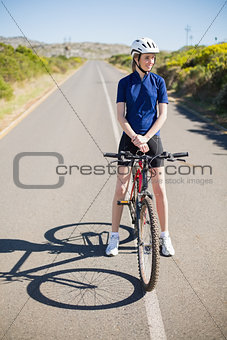 Active woman with her bike