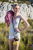 Smiling woman holding climbing equipment